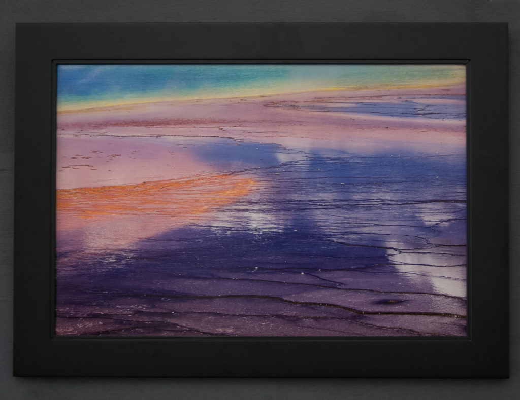 Framed print of Grand Prismatic Spring without glass. Saturation and Contrast are both appear better due to reduced glare.