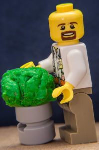 """Lego man standing next to """"the world's largest ball of phlegm."""" Actually, a glob of gum."""