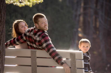 Small family portrait on a bench.